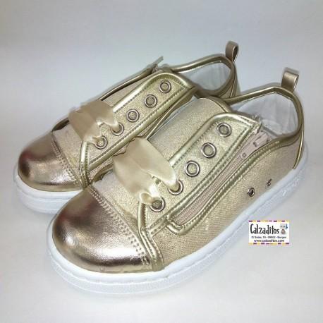 Zapatillas de lona con puntera metalizada y lazos de raso, de Zapy for kids