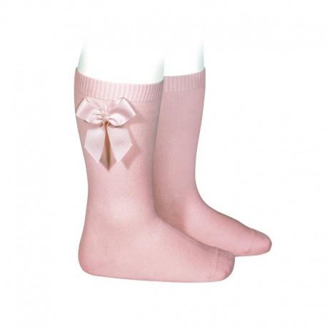 Calcetines altos lisos de color rosa palo con lazo lateral, de Cóndor
