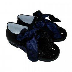 Zapatos tipo blucher para niña con solapa y lazos de Pirufín